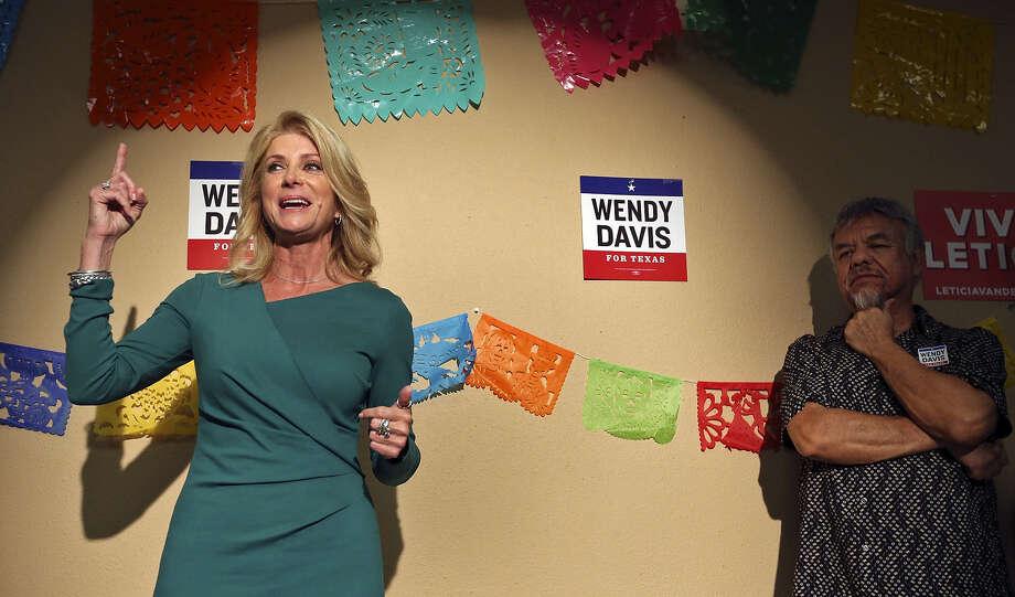 Democratic gubernatorial candidate Wendy Davis speaks as Tejano music legend Joe Hernandez listens on the South Side. Photo: Edward A. Ornelas / San Antonio Express-News / © 2014 San Antonio Express-News