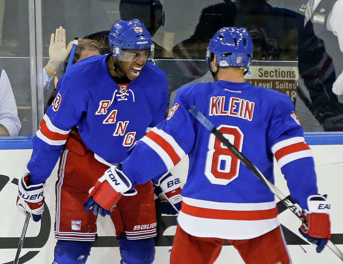 New York Rangers left wing Anthony Duclair (63) celebrates his first career goal with Kevin Klein (8) during the third period of an NHL hockey game against the Minnesota Wild, Monday, Oct. 27, 2014, in New York. The Rangers won the game 5-4. (AP Photo/Frank Franklin II) ORG XMIT: MSG109