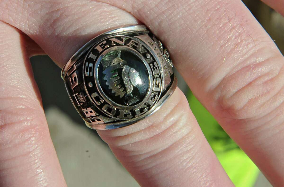 Siena athletic trainer Greg Dashnaw with his 1988 NIT ring which was anonymously returned last week at Siena College on Monday, Oct. 27, 2014 in Loudonville, N.Y. The ring was stolen in 1991. (Lori Van Buren / Times Union)