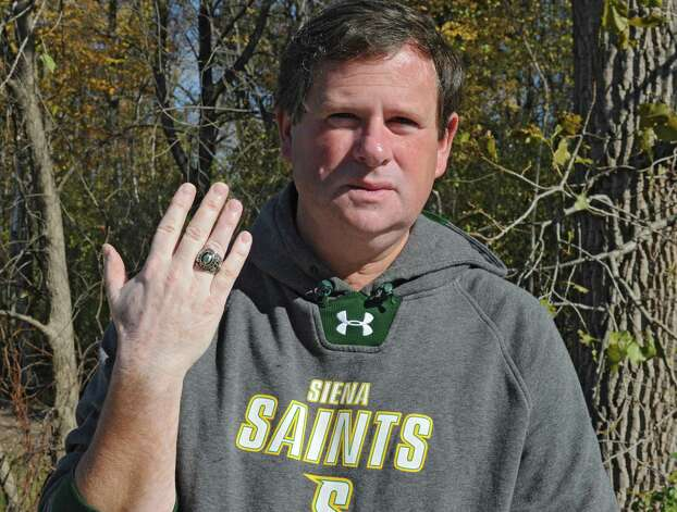 Siena athletic trainer Greg Dashnaw with his 1988 NIT ring which was anonymously returned last week at Siena College on Monday, Oct. 27, 2014 in Loudonville, N.Y. The ring was stolen in 1991. (Lori Van Buren / Times Union) Photo: Lori Van Buren / 00029207A
