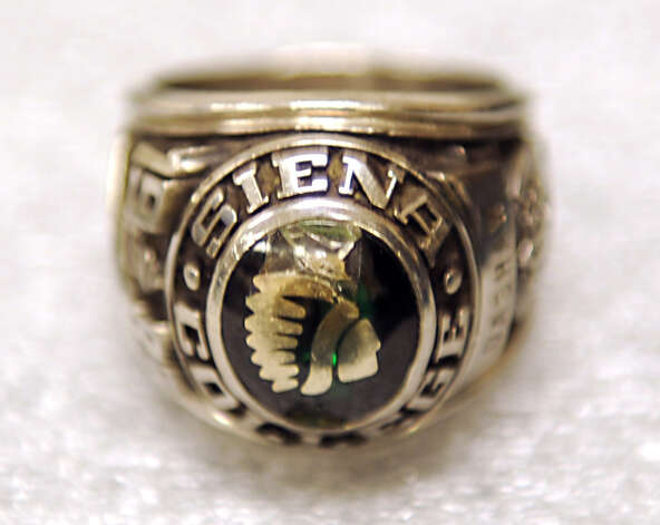 Siena athletic trainer Greg Dashnaw's 1988 NIT ring which was anonymously returned last week at Siena College on Monday, Oct. 27, 2014 in Loudonville, N.Y. The ring was stolen in 1991. (Lori Van Buren / Times Union) Photo: Lori Van Buren / 00029207A