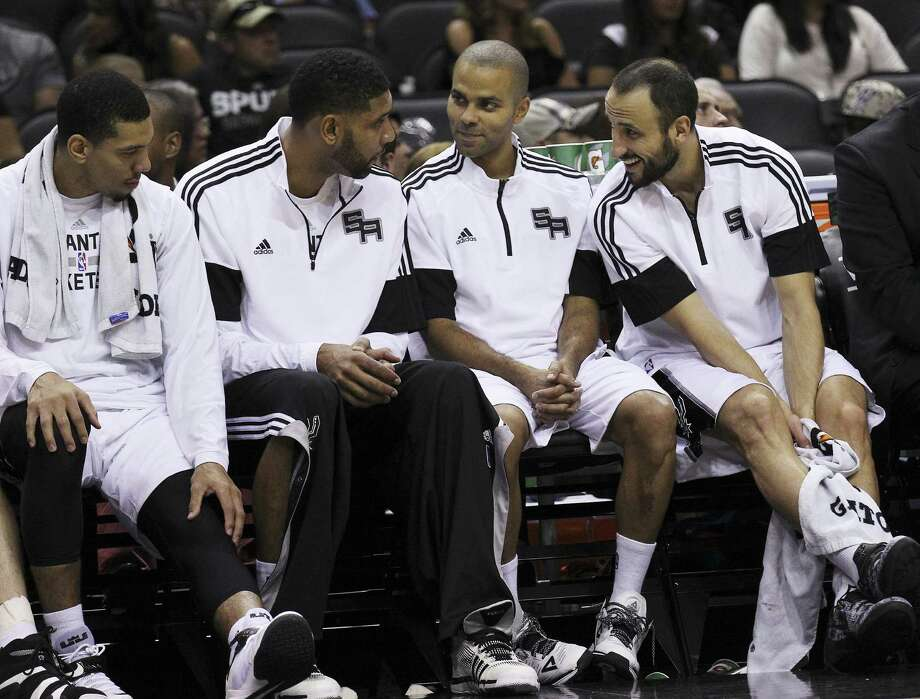 Danny Green, Tim Duncan, Tony Parker, Manu Ginobili and the rest of the Spurs start defending their NBA title tonight. Photo: Kin Man Hui / San Antonio Express-News / ©2014 San Antonio Express-News