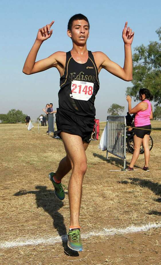 Edison's Raul Almaraz wins the boys' 3-mile run at the District 28-5A cross country meet Friday, Oct. 24, at the San Antonio State Hospital. Photo: Marvin Pfeiffer / Alamo Heights Weekly / EN Communities 2014