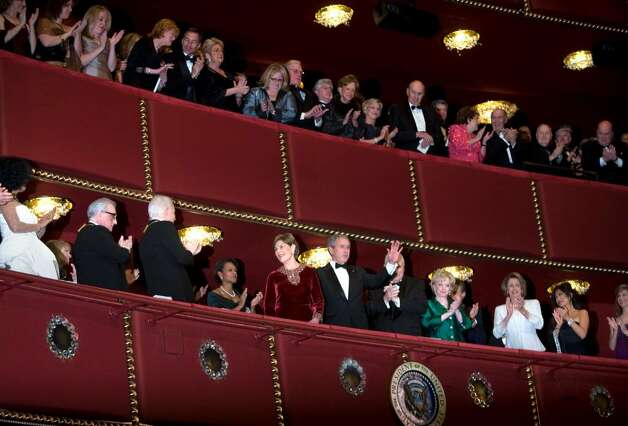 WASHINGTON - DECEMBER 2:  (L-R) Singer Diana Ross, director Martin Scorsese, actor Steve Martin, Secretary of State Condoleezza Rice, Speaker of the House Nancy Pelosi (D-CA) (3-R), Vice President Dick Cheney (5th-R), wife Lynne Cheney (4th-R) and others applaud First Lady Laura Bush (5-L) and President George W. Bush (6th-L) during the 30th Annual Kennedy Center Honors December 2, 2007 in Washington, DC.  Actor Steve Martin, singer Diana Ross, pianist Leon Fleisher, director Martin Scorsese and musician Brian Wilson were honored for their contribution to the American arts.  (Photo by Brendan Smialowski/Getty Images) *** Local Caption *** George W. Bush;Laura Bush;Lynne Cheney;Dick Cheney;Nancy Pelosi;Condoleezza Ric;Steve Martin;Martin Scorsese;Diana Ross Photo: Brendan Smialowski, Getty Images / 2007 Getty Images