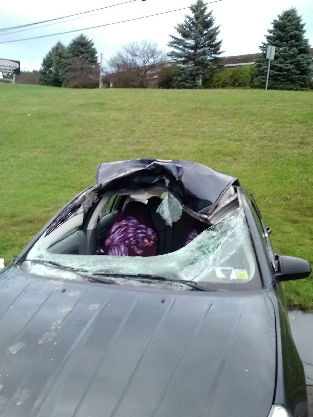 Damage to a car after a deer collision on Saturday, Oct. 25, 2014, in Cobleskill. (Photo provided by Schoharie County Sheriff's Office)