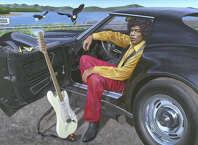 Jimi Hendrix and his Corvette are seen in upstate New York during the summer of 1969, in a painting by New Milford artist Chris Osborne.