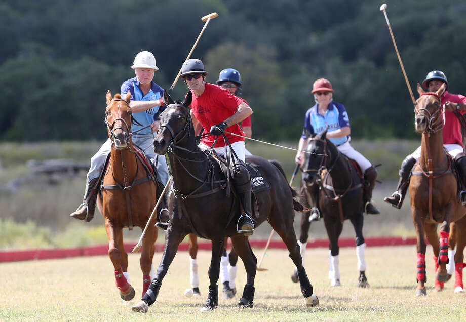 Jack Cray, left, and Gal Shweiki, center, chase down a ball during a game at the San Antonio Polo Club's practice field, 285 Obst Road in Bulverde earlier this month. Photo: Photos By Marvin Pfeiffer / Alamo Heights Weekly / EN Communities 2014