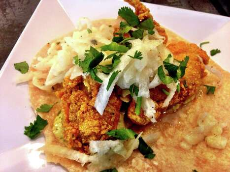 Fried oyster taco at Tacos and Tequila Photo: Courtesy Tacos And ...