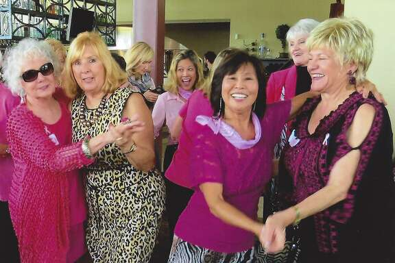 """Hi Neighbor members Billie Breland-Smith left, with Rene' Johnson, and MinhChau with Nedra Karp dance to the music of the """"Grateful Geezer"""" band at the social club's October luncheon."""
