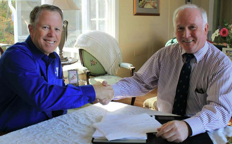 Philip Dwyer, right, officially took over as the interim chief executive officer of the Westport Weston Family Y on Monday. He took over the position formerly held by Ropb Reeves, left, who announced his resignation on Oct. 20 after a six-year tenure. Photo: Contributed Photo / westport news