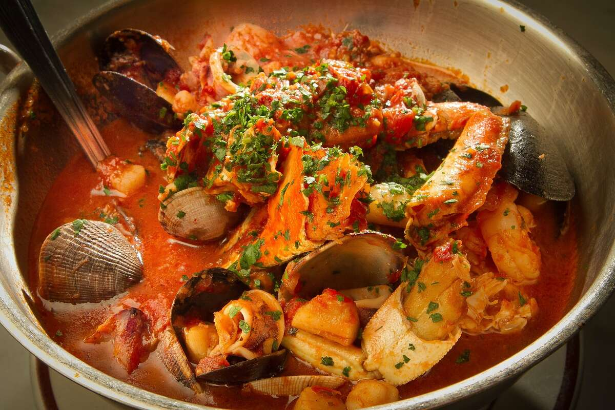 Iconic dishes, drinks and snacks of the Bay Area Cioppino:Developed by Italian fisherman in the late 1800s, cioppino is now found throughout old school Italian restaurants across San Francisco, like Tadich Grill where its a signature item. There are several creation myths surrounding the tomato-based seafood stew, but the best one might be the one about how the name came from fishermen asking cohorts to