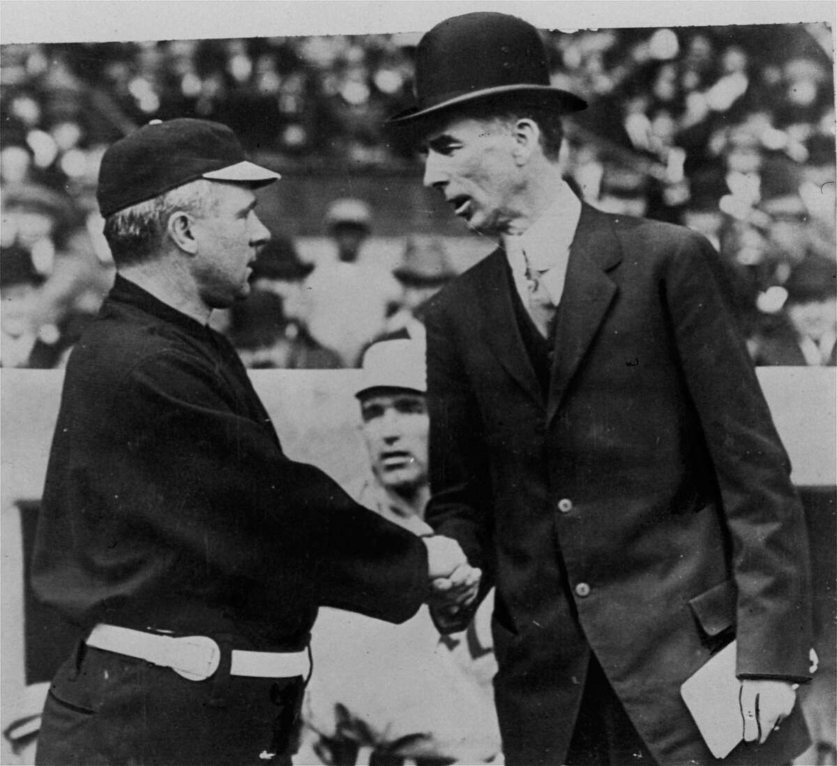 1911: Opposing managers Connie Mack, right, and John McGraw, at the opening game of the 1911 World Series, New York City, October 14, 1911. Mack's Philadelphia Athletics defeated McGraw's New York Giants in 6 games.