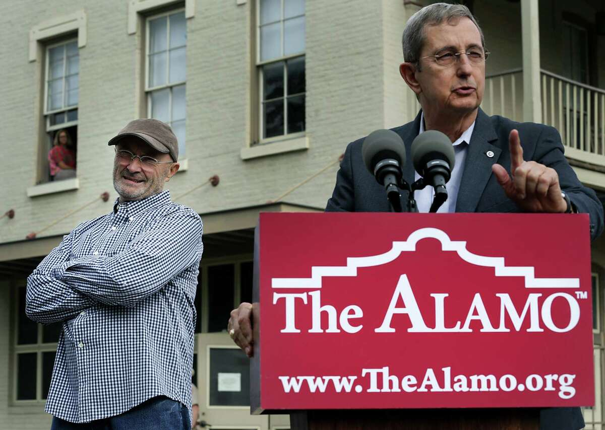 Texas Land Commissioner Jerry Patterson, right, addresses the media as Phil Collins waits to make comments about the historic items he donated to the Alamo. Tuesday Oct. 28, 2014.