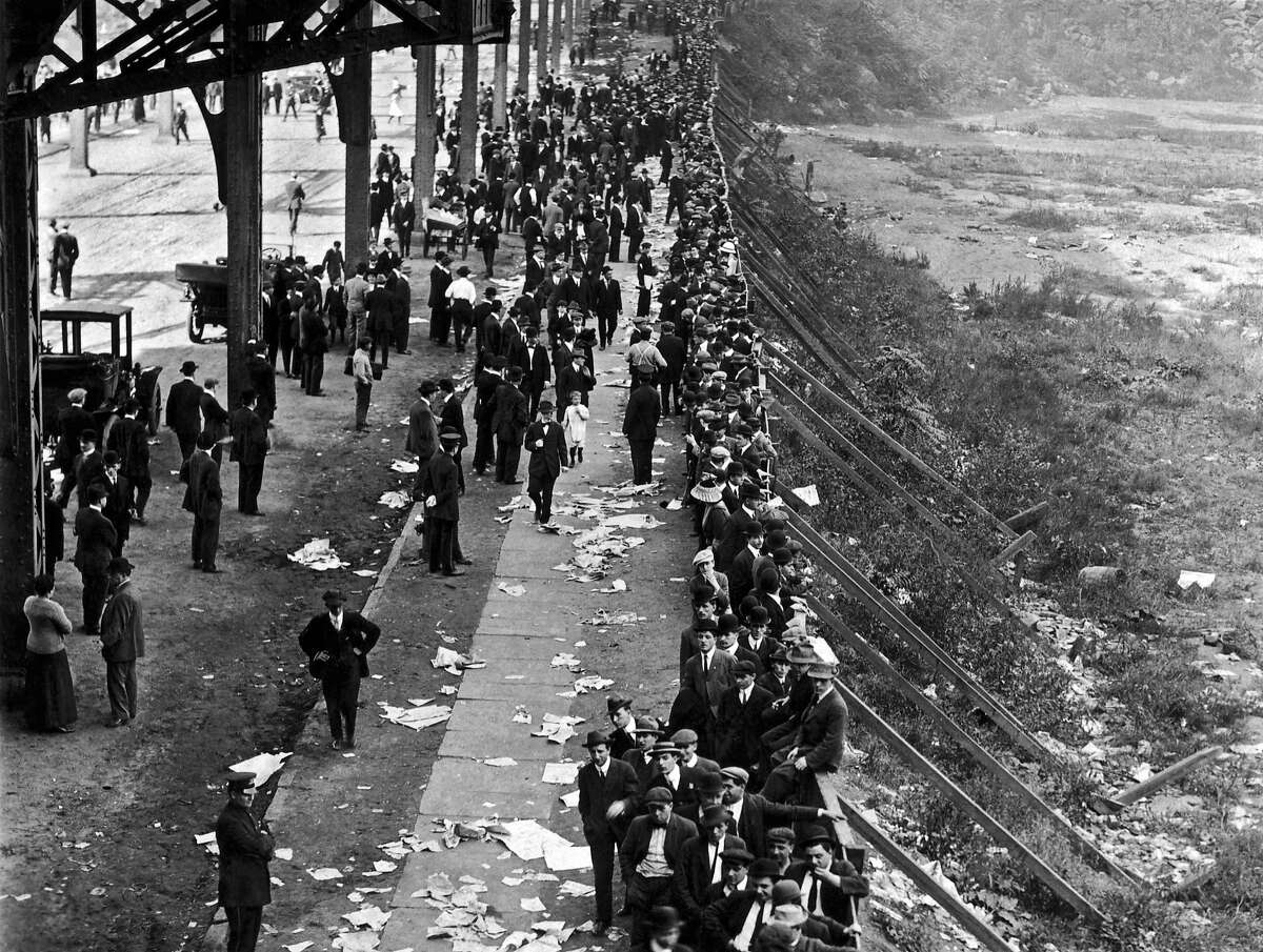 1912: Fans waiting in line at the Polo Grounds for tickets for the first game of the 1912 World Series between the New York Giants and the Boston Red Sox, New York, New York, October 7, 1912. The Giants won Game 6 5-2 and evened the series with an 11-4 blowout in Game 7, but lost the title in the eighth game when the Red Sox scored twice in the bottom of the 10th.
