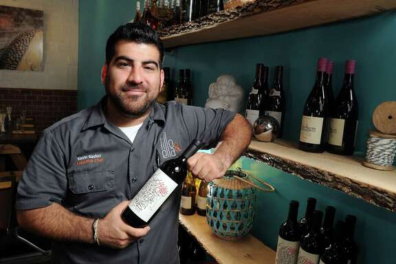 Chef Kevin Naderi at Lilo & Ella with a 2012 Idle Hands wine  Tuesday Oct 21, 2014.(Dave Rossman photo)