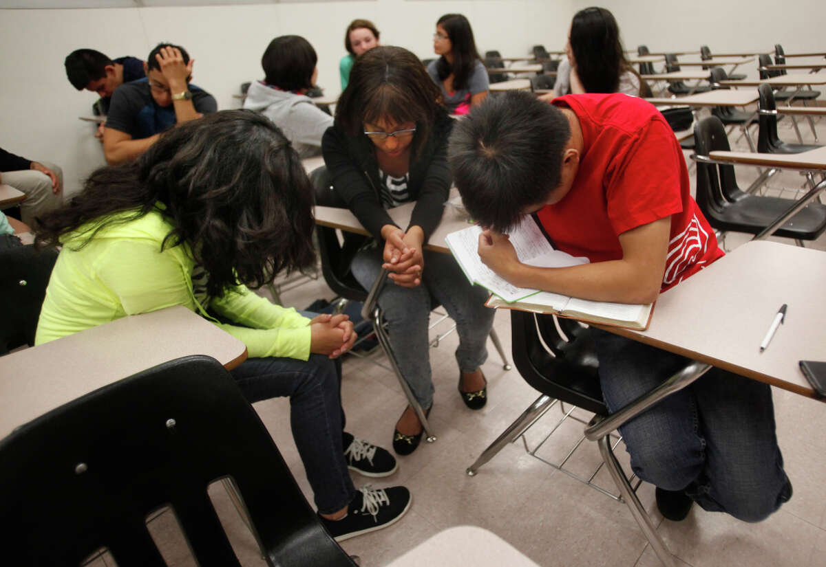 Cal State Northridge students pray at Intervarsity Christian Fellowship, which objects to a policy that would make nonbelievers eligible for club leadership.