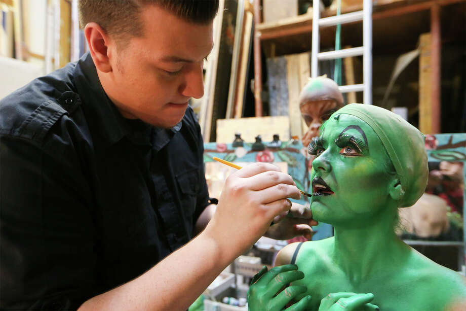 """Zack Smith (left) applies makeup to Asia Ciaravino in her costume change from Ms. Gultch into the Wicked Witch during the performance of """"The Wizard of Oz"""" at The Playhouse-San Antonio. Photo: MARVIN PFEIFFER, STAFF / Marvin Pfeiffer/ EN Communities / Express-News 2014"""