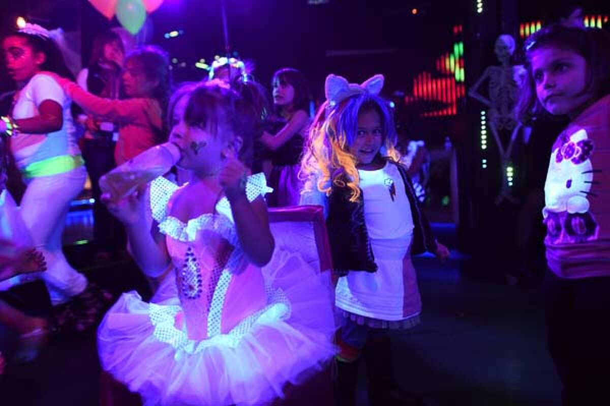 Kids in Halloween costumes party the day away at an electronic dance music event organized by CirKiz at a night club in New York on Oct. 26.