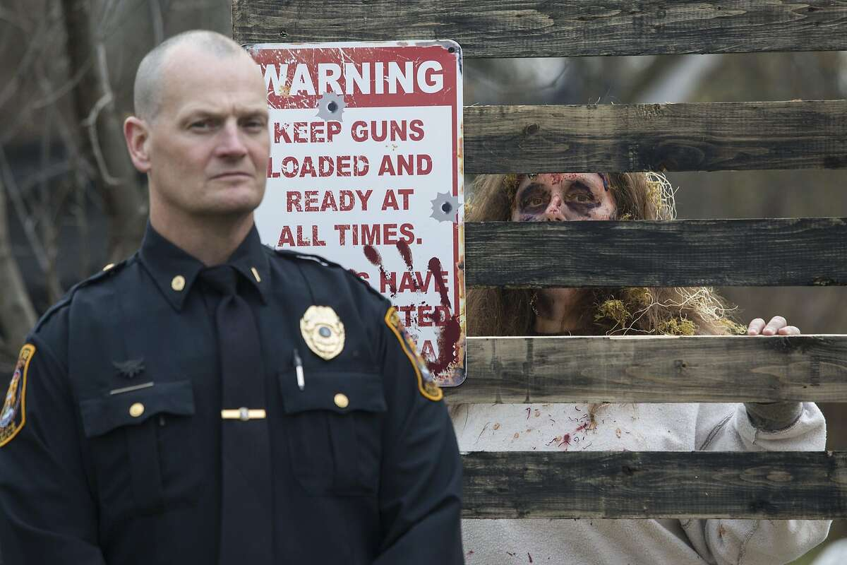 PUBLIC SAFETY MESSAGE OF THE DAY: Police in Burton, Mich., team up with zombies to kick off their new Click It Or Ticket campaign at Burton Haunted Forest. Under a new law, those caught not wearing seat belts in moving cars will be fined $65.
