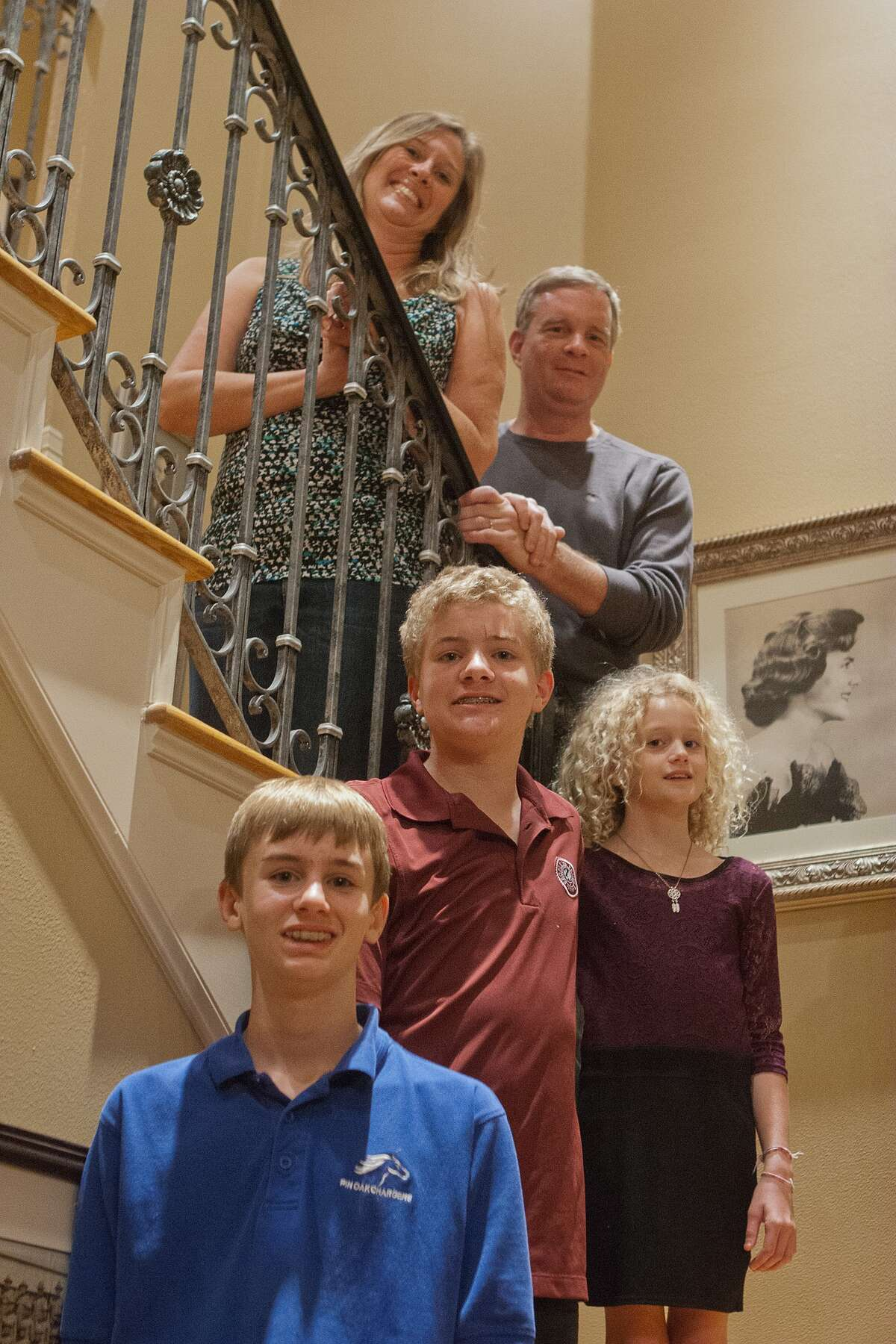 Lagenia and David Clark of Bellaire are spearheading a gala to raise funds to research giant axonal neuropathy, a rare disease that affects two of their children, Justin, center, and Lexi, right. Their other child, Jared, has run triathlons to raise research funds.