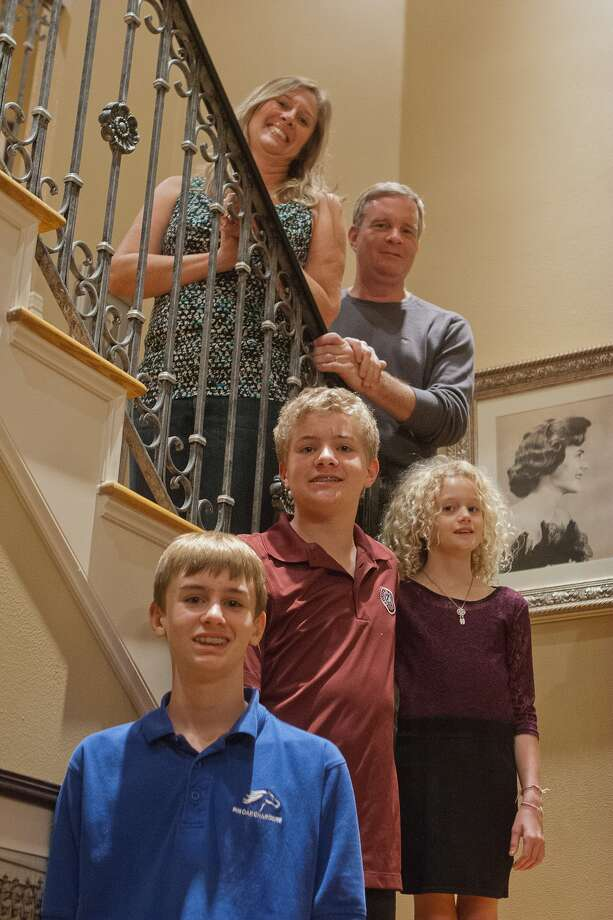 Lagenia and David Clark of Bellaire are spearheading a gala to raise funds to research giant axonal neuropathy, a rare disease that affects two of their children, Justin, center, and Lexi, right. Their other child, Jared, has run triathlons to raise research funds. Photo: R. Clayton McKee, Freelance / © R. Clayton McKee
