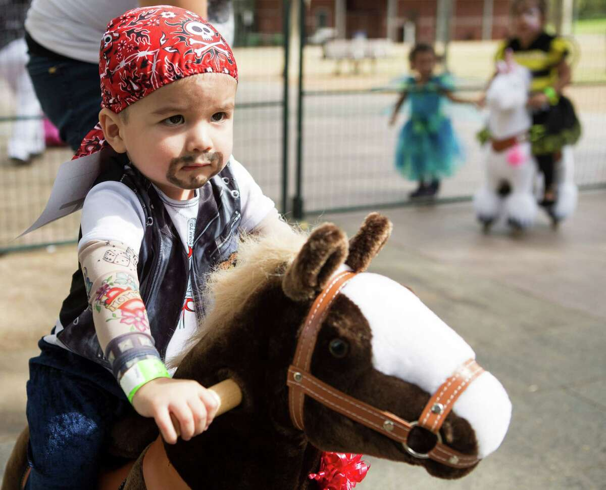 Gael Garza rides a toy horse during a special Toddler Tuesday Halloween Ball at Discovery Green Tuesday, Oct. 28, 2014, in Houston. Children were treated to story time, dancing and a costume contest during the midday event.