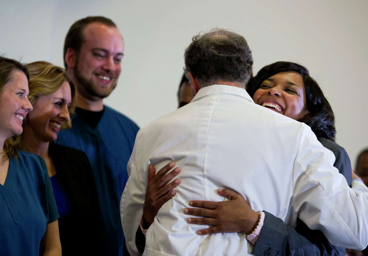 Amber Vinson (right), the Dallas nurse who was treated for Ebola, embraces Emory University Hospital epidemiologist Dr. Bruce Ribner after she was discharged from the hospital.