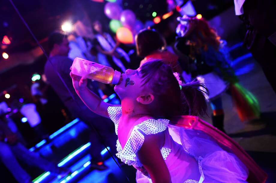 Kids in Halloween costumes party the day away at an electronic dance music event organized by CirKiz at a night club in New York on Oct. 26. According to the CirKiz website, the parties are meant to recreate the EDM experience for tiny future enthusiasts in a kid-friendly environment.  Photo: Jewel Samad, AFP/Getty