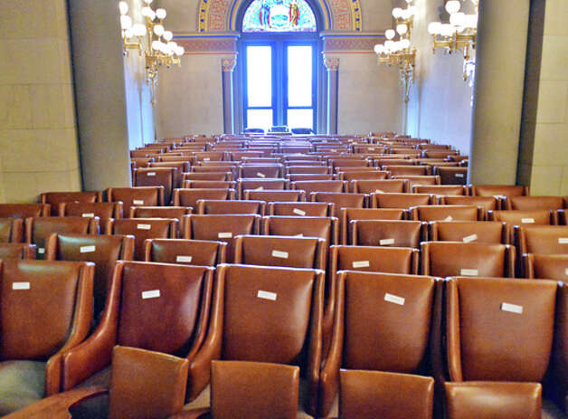 Legislator's desks and chairs fill the NYS State Assembly Parlor having been removed for a pre-season cleaning Friday Oct. 24, 2014, at the State Capitol in Albany, NY. (John Carl D'Annibale / Times Union) Photo: John Carl D'Annibale, Albany Times Union