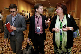 """Matthew Vines (center,) author of """"God and the Gay Christian,"""" visits with Devin Kennamer and Kathy Baldock, right, during the Ethics and Religious Liberty Commission National Conference on Tuesday, Oct. 28, 2014, in Nashville, Tenn. Southern Baptists organized the three-day event to strengthen the resolve of Christians preaching the increasingly unpopular view that gay relationships are sinful. (AP Photo/Mark Humphrey)"""