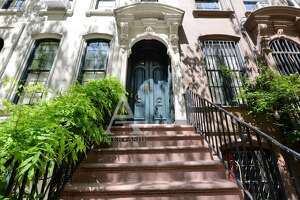 """The """"Breakfast at Tiffany's"""" apartment is for sale. The 3,800-square-foot brownstone  at 169 East 71st Street in Manhattan boasts 4 bedrooms, 5 bathrooms, a sweeping staircase and an enclosed greenhouse."""