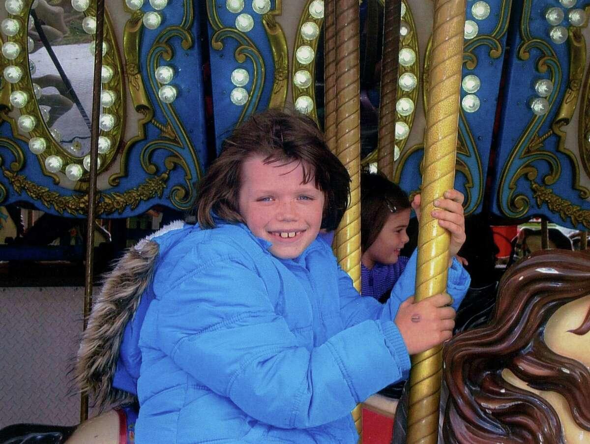 Faith McCoy of the Fonda area rides the merry-go-round at Altamont Fair. (Daniel Frinta)