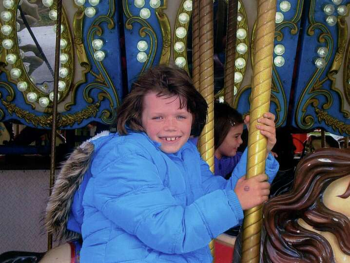 Faith McCoy of the Fonda area rides the merry-go-round at Altamont Fair. (Daniel Frinta)