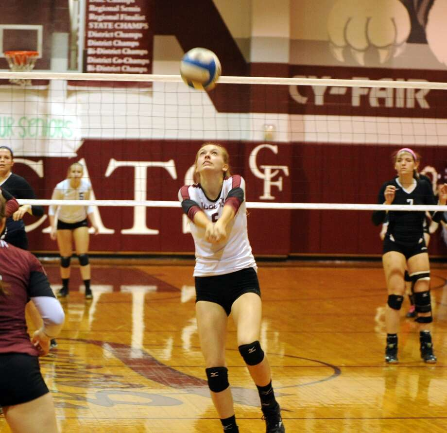 Cy Creek volleyball team played a match at Cy Fair High School, 10-24-2014.  Cy Fair won the match in three games to none.  Cy Fair's Catherine Isaley (5) is all concentration as she prepares to pass the ball to a teammate. Photo: Eddy Matchette, Freelance