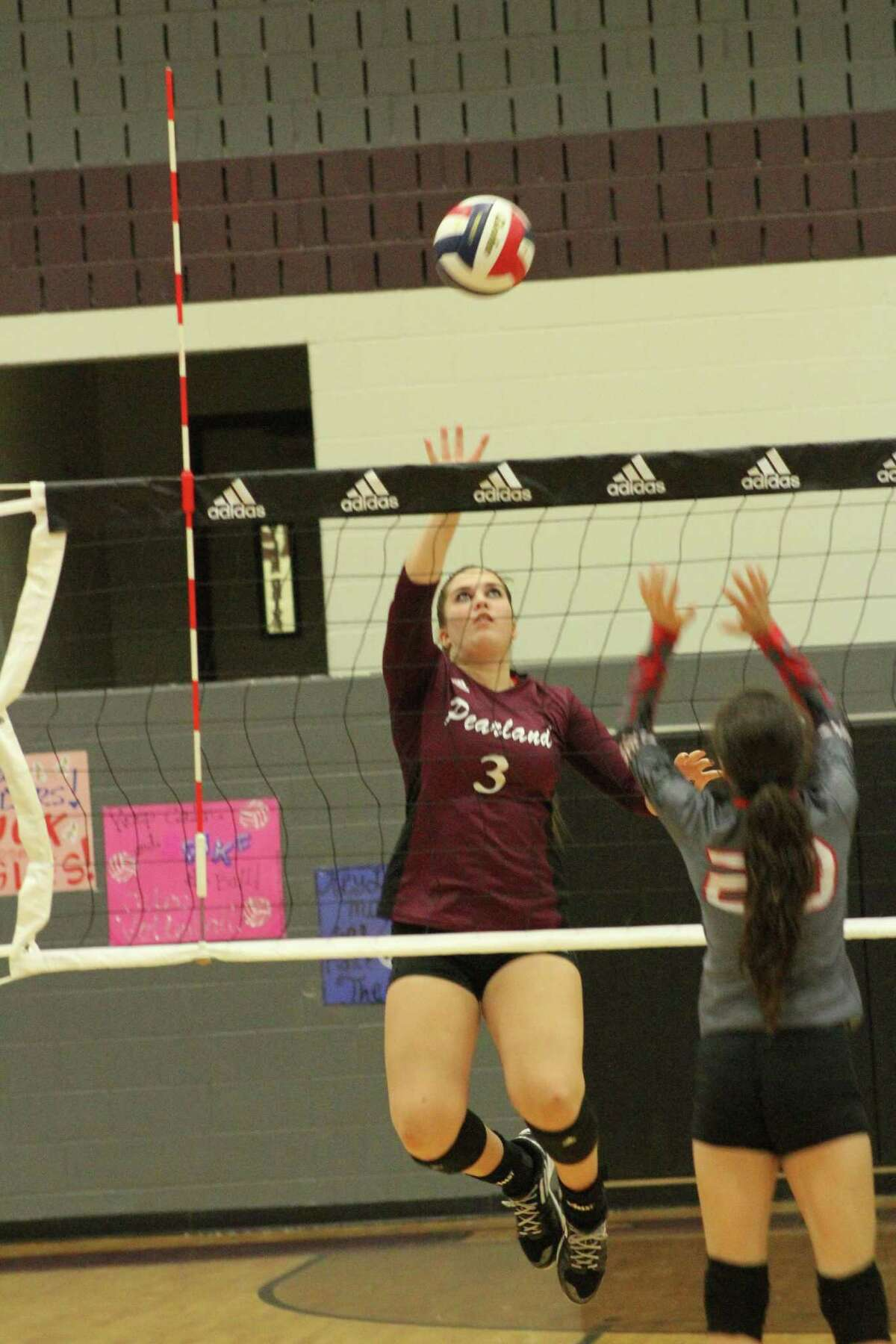 Number 3, Hannah Ofczarzak for Pearland goes for a kill vs South Houston.