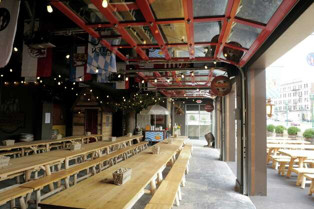 A view of the inside of the new Wolff's Biergarten at 165 Erie Blvd. in Schenectady, seen here on Tuesday, Oct. 28, 2014.  Three large garage doors are opened on the front of the building for nice weather.  (Paul Buckowski / Times Union) Photo: Paul Buckowski / 00029217A
