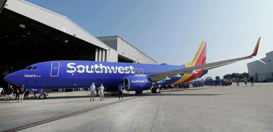 A Southwest Airlines plane sporting the newly unveiled paint color scheme sits outside a hanger at Love Field. Southwest will begin nonstop service from San Antonio to Mexico City on Sunday, taking over the route previously operated by AirTran Airways. Photo: LM Otero / LM Otero / Associated Press / AP
