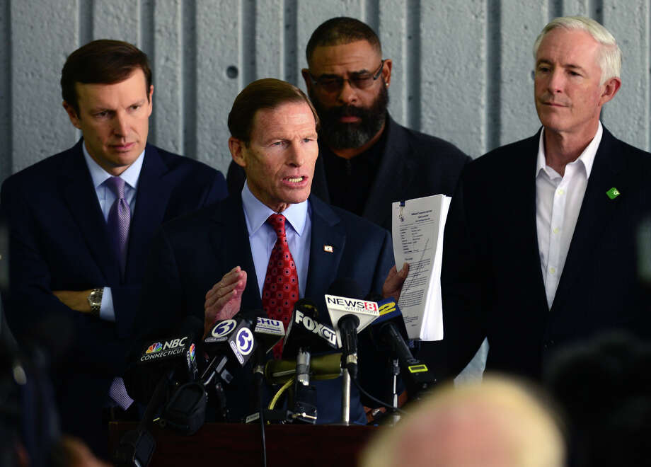 """U.S. Senator Richard Blumenthal (D-Conn.) speaks to the media about the report released by the National Transportation Safety Board and its findings in the five major accidents involving Metro-North Railroad, during a press coference held at the Bridgeport Metro-North Railroad station in downtown Bridgeport, Conn. on Tuesday October 28, 2014. Behind Senator Blumenthal at left is U.S. Senator Chris Murphy (D-Conn.), State Representative Charles """"Don"""" Clemons, Jr. (D-Bridgeport), and Bridgeport Mayor Bill Finch, right. Also present but not pictured is U.S. Congressman Jim Himes (D-4). Photo: Christian Abraham / Connecticut Post"""