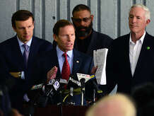 """U.S. Senator Richard Blumenthal (D-Conn.) speaks to the media about the report released by the National Transportation Safety Board and its findings in the five major accidents involving Metro-North Railroad, during a press coference held at the Bridgeport Metro-North Railroad station in downtown Bridgeport, Conn. on Tuesday October 28, 2014. Behind Senator Blumenthal at left is U.S. Senator Chris Murphy (D-Conn.), State Representative Charles """"Don"""" Clemons, Jr. (D-Bridgeport), and Bridgeport Mayor Bill Finch, right. Also present but not pictured is U.S. Congressman Jim Himes (D-4)."""