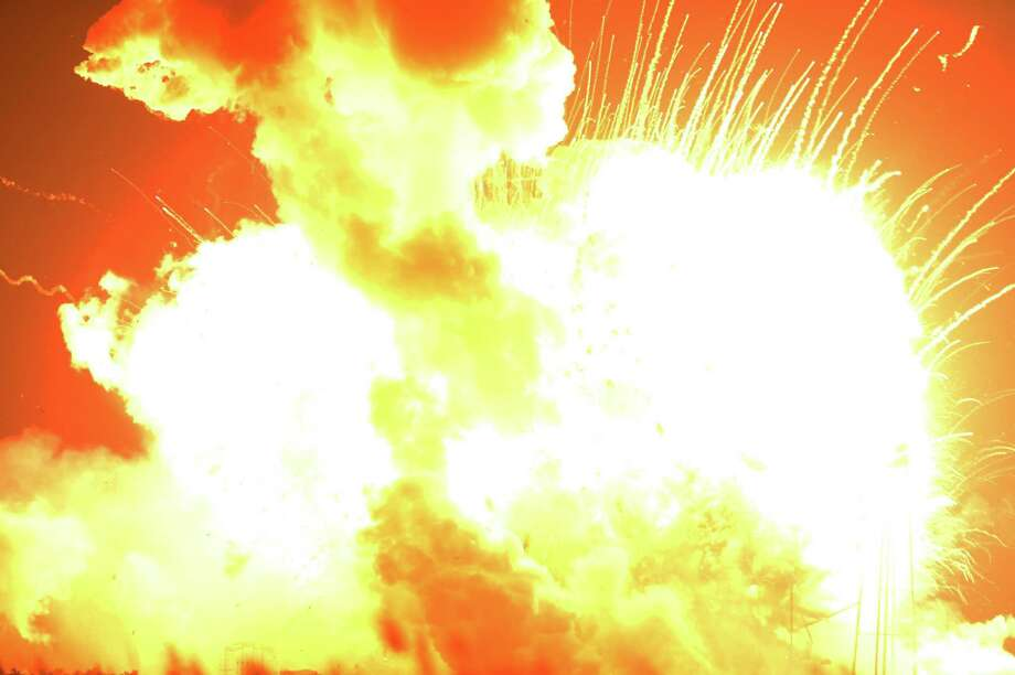 An unmanned Orbital Sciences Corp.'s Antares rocket explodes shortly after takeoff at Wallops Flight Facility on Wallops Island, Va. on Tuesday, Oct. 28, 2014. No injuries were reported following the first catastrophic launch in NASA's commercial spaceflight effort. Photo: Jay Diem, AP / Eastern Shore News