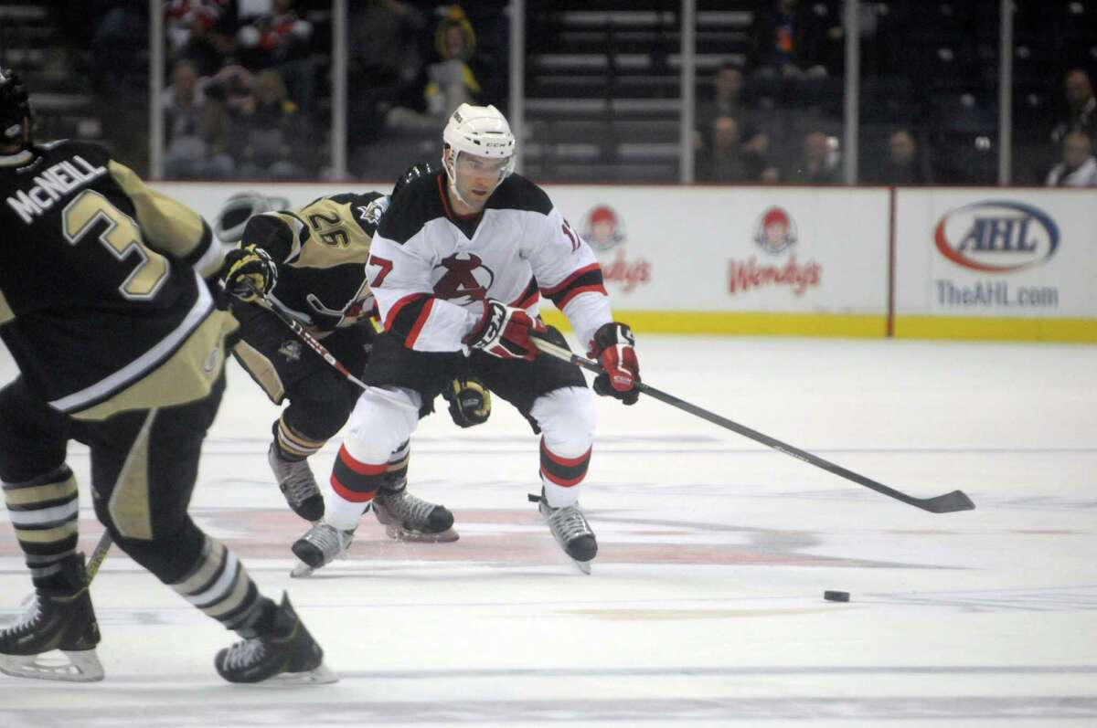 Scott Timmins with the Devils brings the puck up the ice during their game against the Penguins on Tuesday, Oct. 21, 2014, in Albany, N.Y. (Paul Buckowski / Times Union)