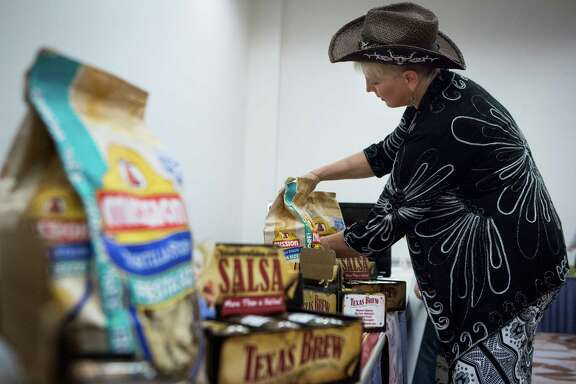 Brenda Craig of Texas Brew Salsa prepares her wares for the Go Texan Product Showcase on Tuesday at NRG Center. The event, sponsored by the Texas Department of Agriculture, gives Texas-based vendors a chance to do business with major retailers.