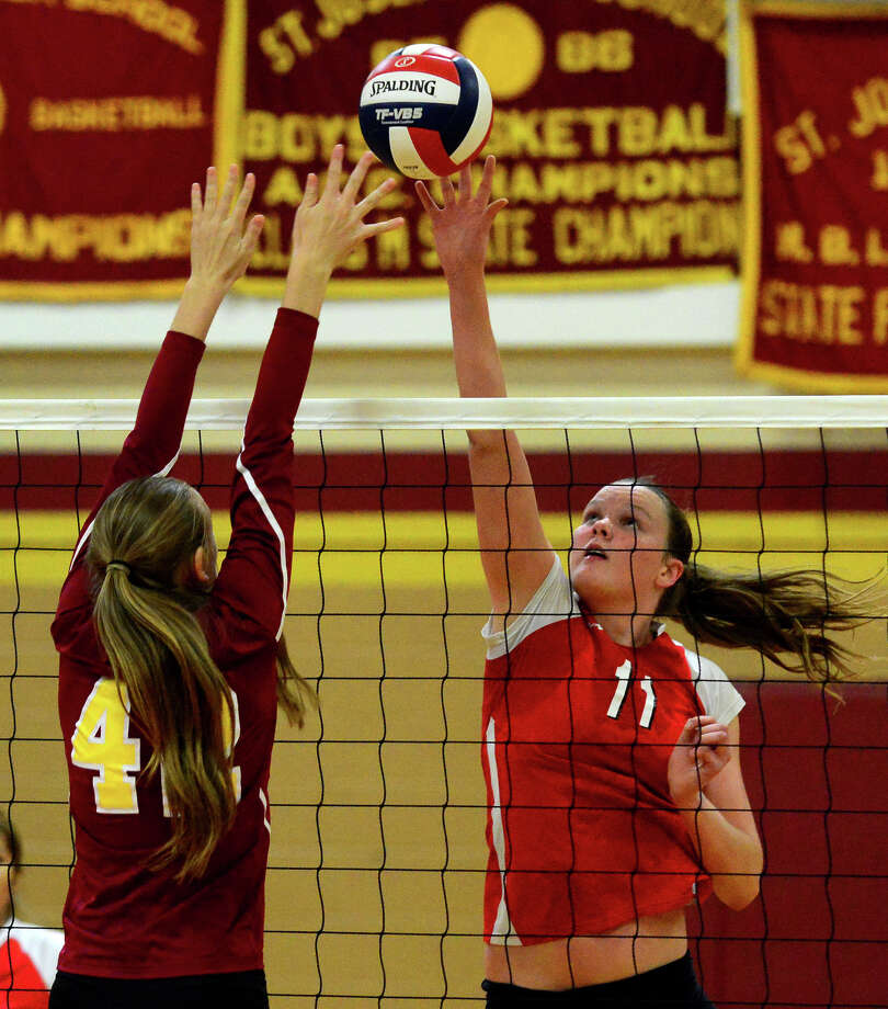 Greenwich's Abbie Wolf looks to tap the ball past St. Joseph's Jacqueline Jozefick, during FCIAC girls volleyball quarterfinal action in Trumbull, Conn. on Tuesday October 28, 2014. Photo: Christian Abraham / Connecticut Post