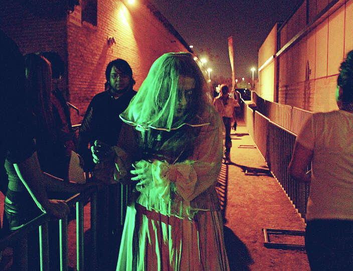 Photos capture scare seekers faces of fear during october for 13th floor haunted house san antonio