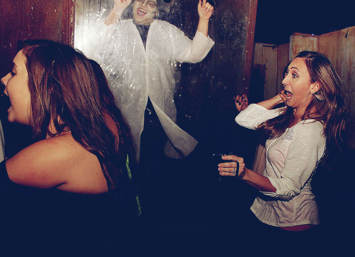 Photos capture scare-seekers' faces of fear during October 2014, at the 13th Floor Haunted House in San Antonio, which was named one of the scariest in the country. Hauntworld Magazine named it scariest haunted attractions of 2011, 2012, and 2013.