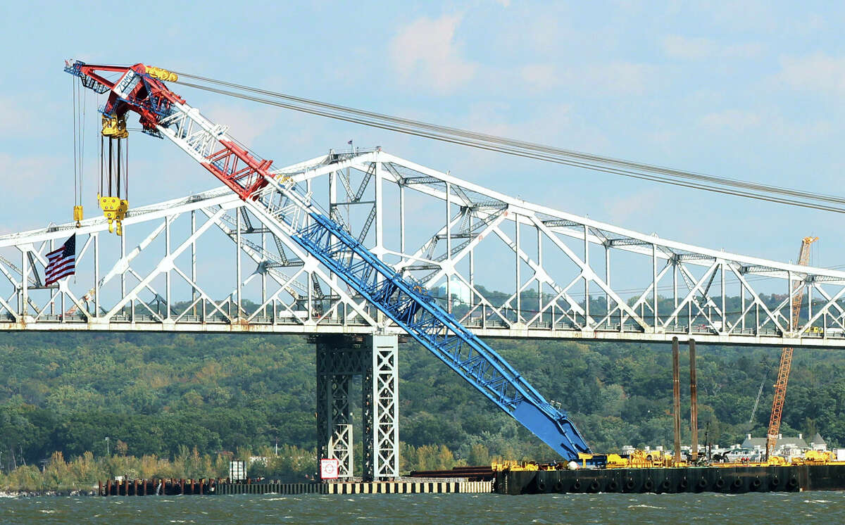 The Left Coast Lifter, one of the world's largest floating cranes, is put in position in front of the Tappan Zee Bridge on the Hudson River on October 6, 2014 seen from Piermont, New York. The super crane was brought over from California to aid in the replacement of Tappan Zee Bridge and construction of the New New York Bridge that connects Rockland and Westchester counties. The crane has a boom length of 328 feet, can lift 1,900 tons and sits on a 384-foot barge. (Photo by Jim Alcorn/Getty Images) ORG XMIT: 517158755