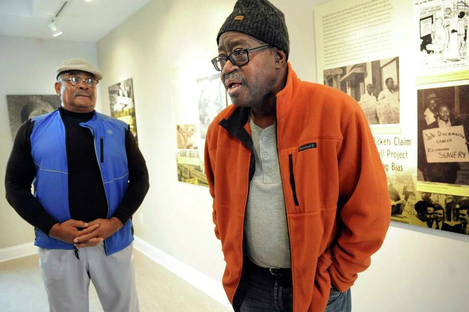 Persell McDowell, left, and Earl Thorpe, both former members of The Brothers talk about the exhibit honoring that movement on Tuesday, Oct. 28, 2014, at King's Place in Albany, N.Y. (Cindy Schultz / Times Union) Photo: Cindy Schultz / 00029209A