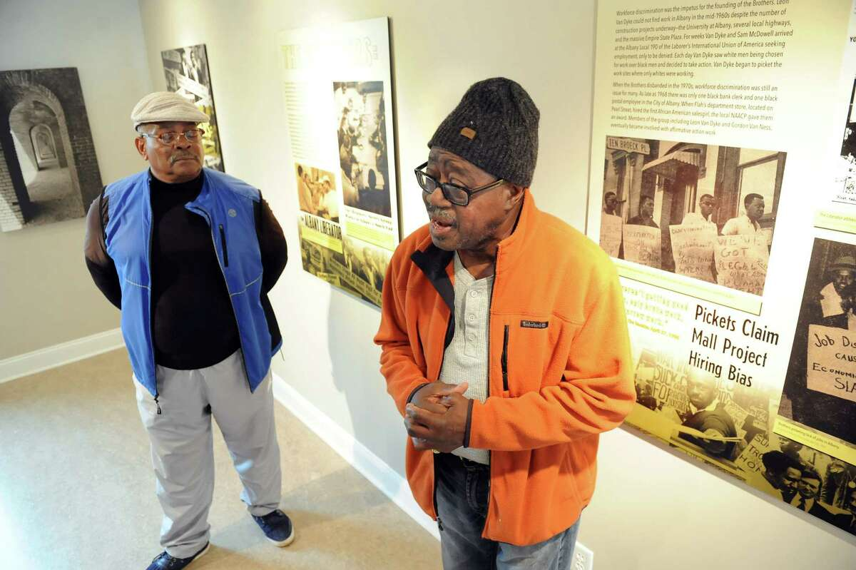 Persell McDowell, left, and Earl Thorpe, both former members of The Brothers talk about the exhibit honoring that movement on Tuesday, Oct. 28, 2014, at King's Place in Albany, N.Y. (Cindy Schultz / Times Union)