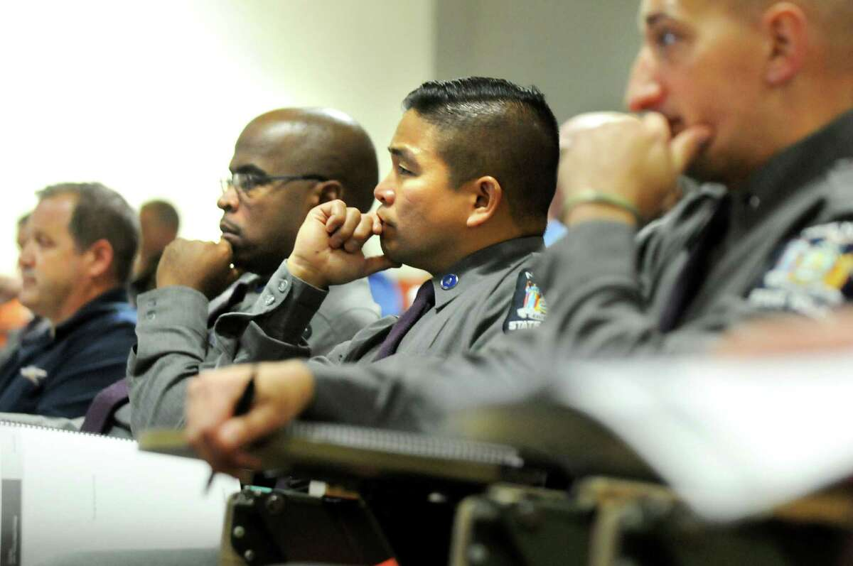 State Trooper Aaron Kawado, center, attends training in how to assist military veterans who are in crisis on Tuesday, Oct. 28, 2014, at the State Police Academy in Albany, N.Y. The training focuses on how to communicate and de-escalate a situation. (Cindy Schultz / Times Union)