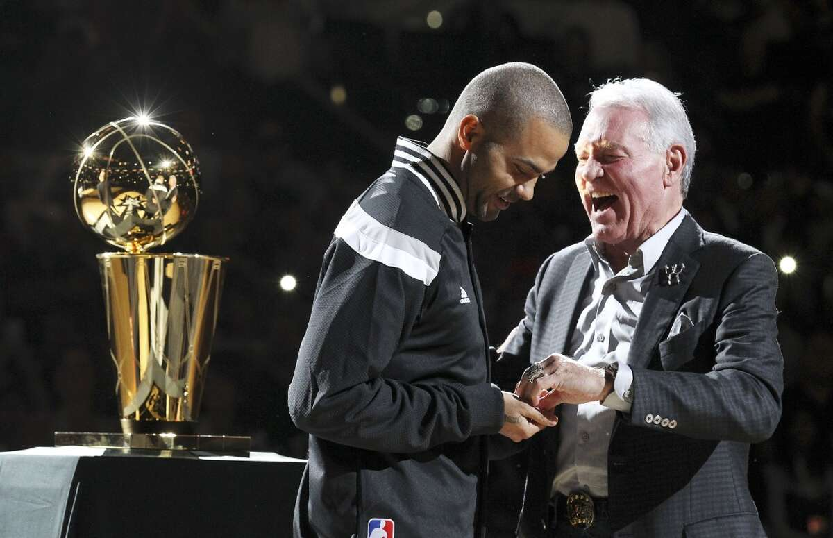 Spurs' Tony Parker receives his 2014 NBA Championship ring from team owner Peter Holt during the ring ceremony and season opener against the Dallas Mavericks at the AT&T Center on Tuesday, Oct. 28, 2014. (Kin Man Hui/San Antonio Express-News)
